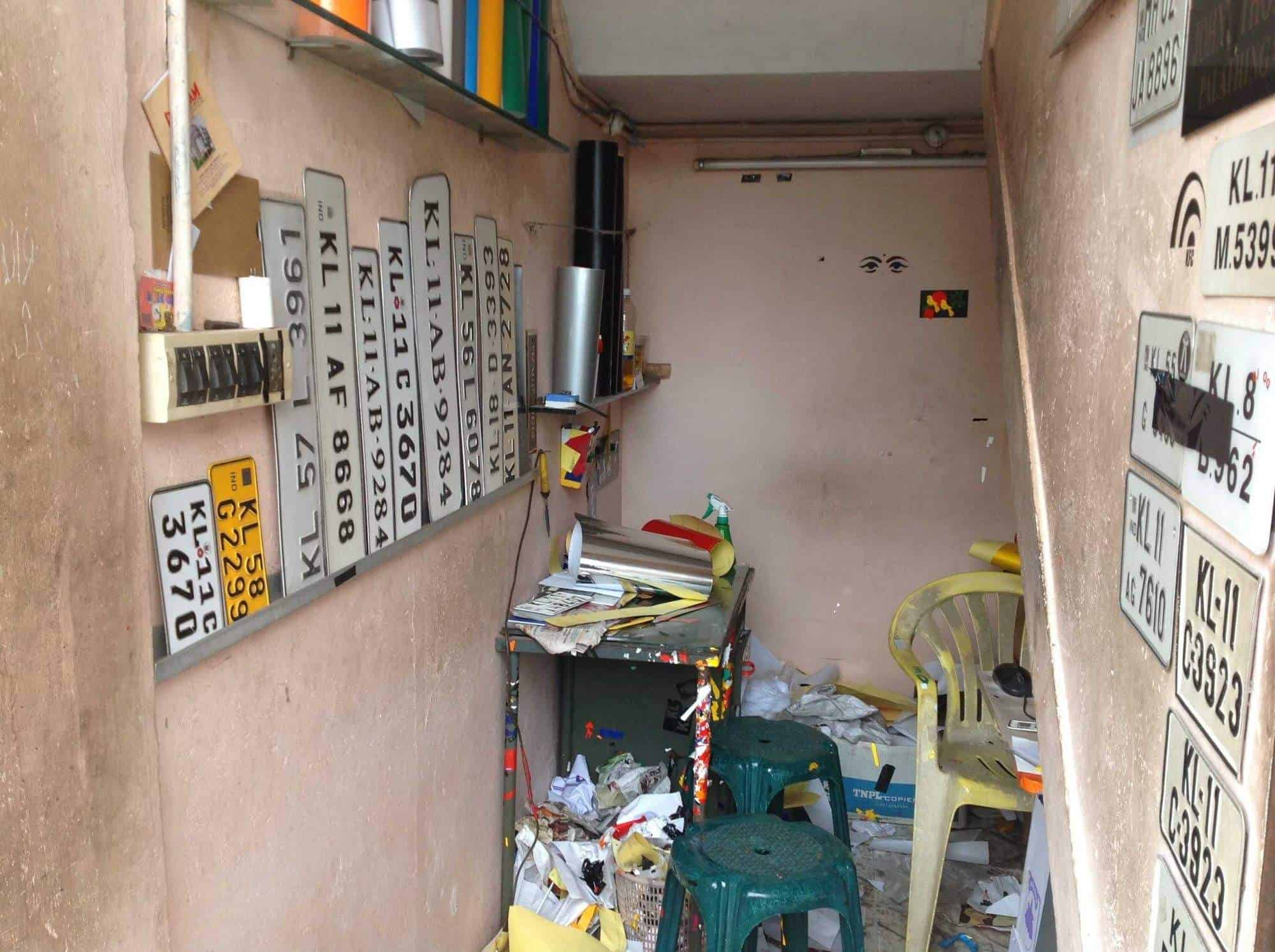 Inside view of number plate manufacturers shop nice sticker cutting photos ymca road