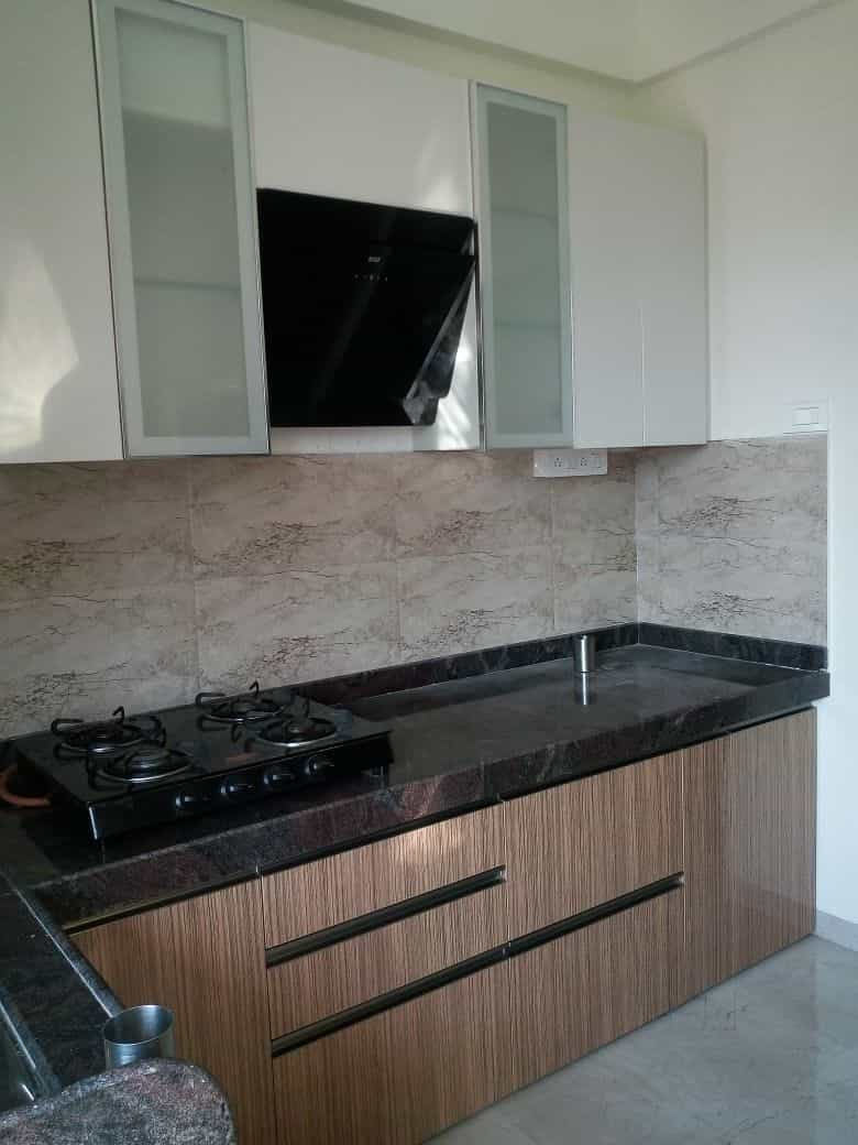 ... Ashiyana Interiors Photos, Patlipada-Thane West, Mumbai - Interior Designers · Front View Of Modular Kitchen ...