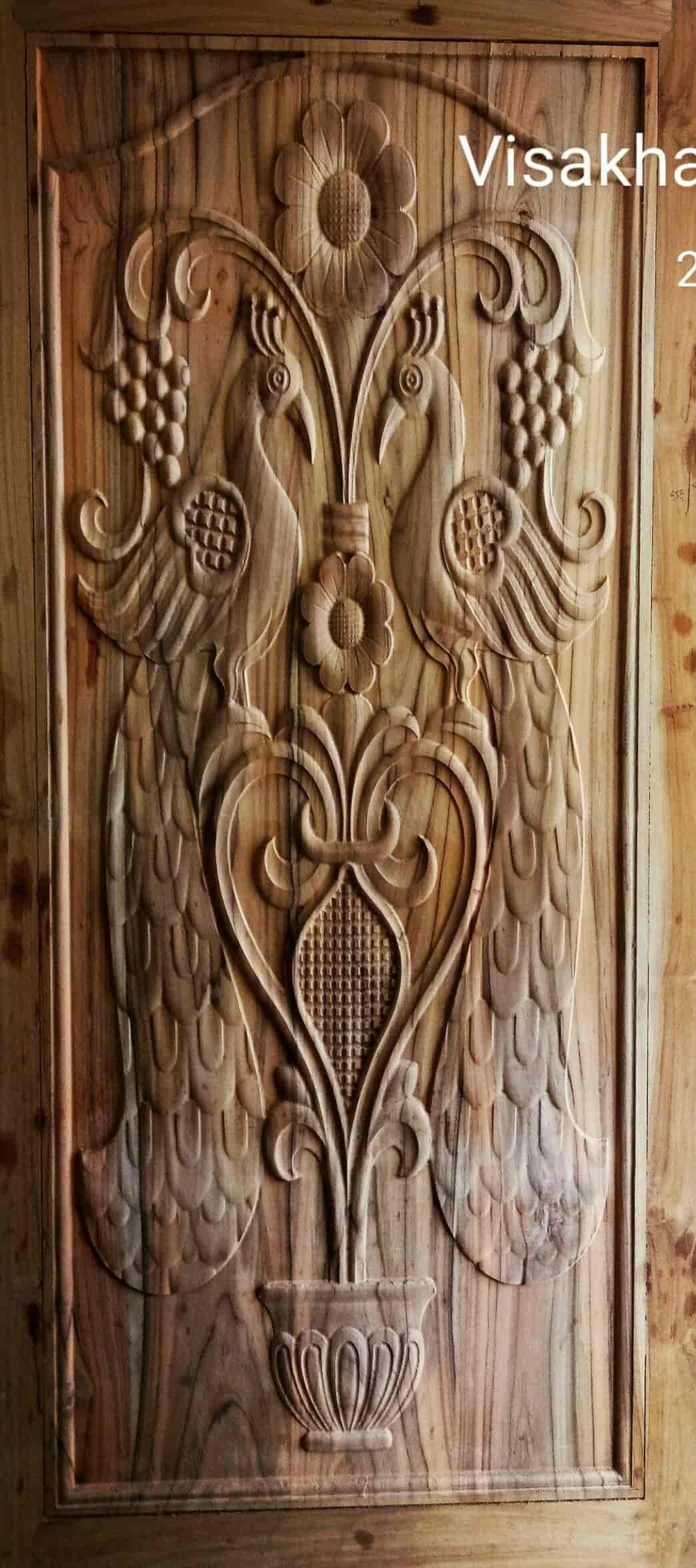 Js wood design works marripalem wood carving dealers in